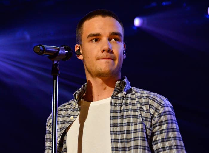 Liam looks serious while performing