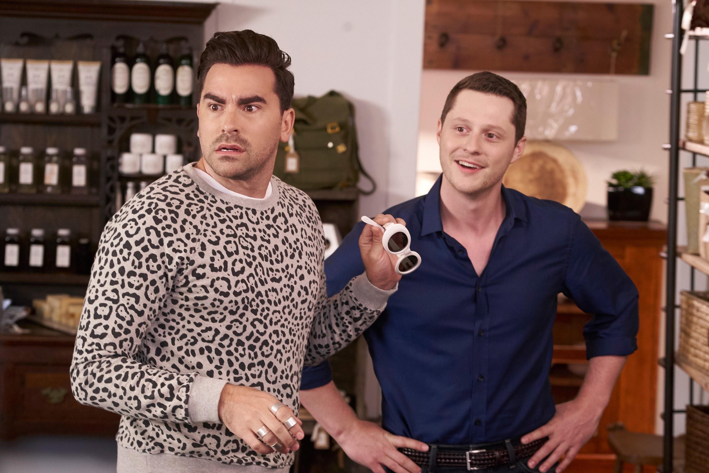 Dan Levy looks annoyed while Noah Reid looks amused