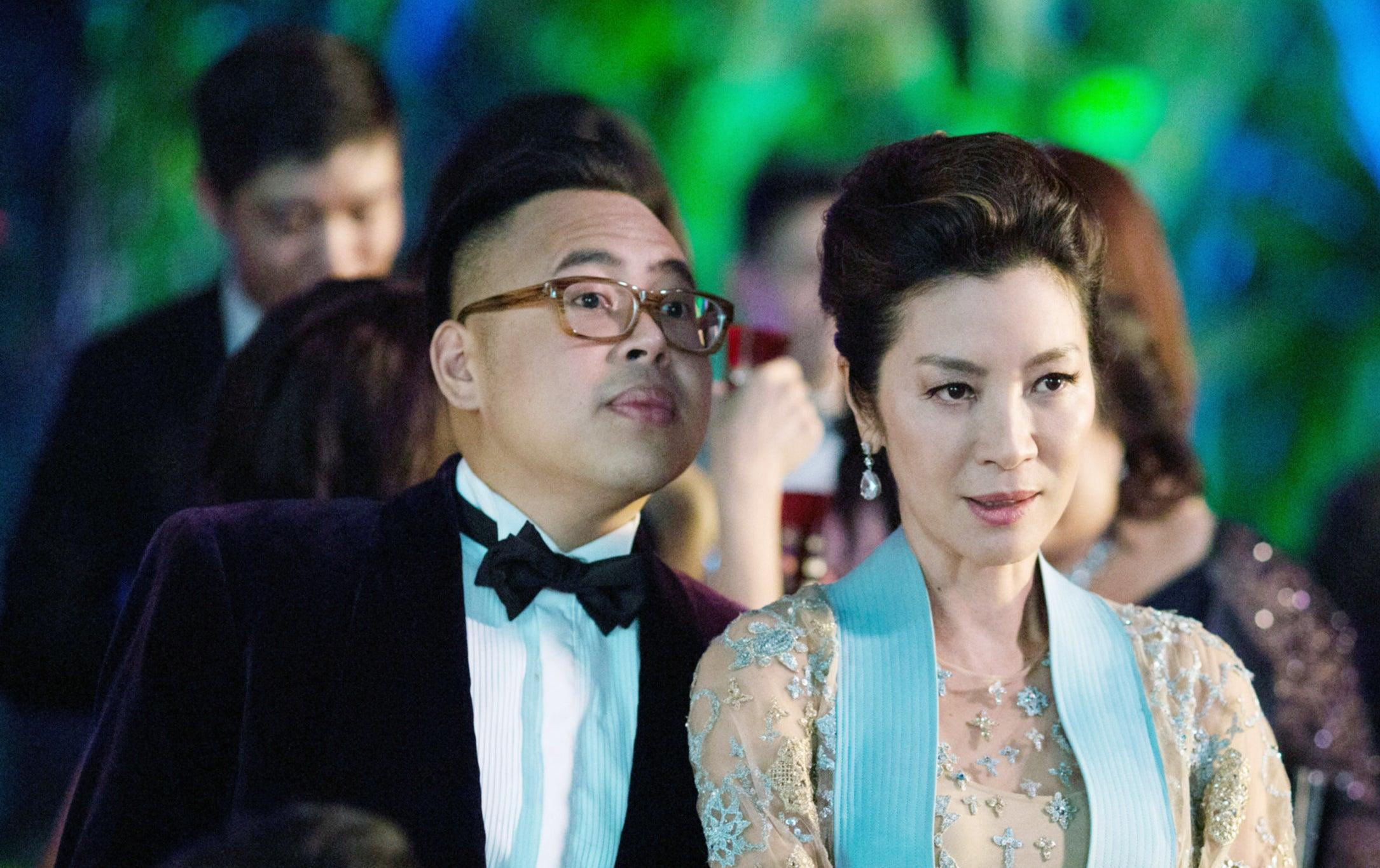 Nico Santos spies over Michelle Yeoh's shoulder
