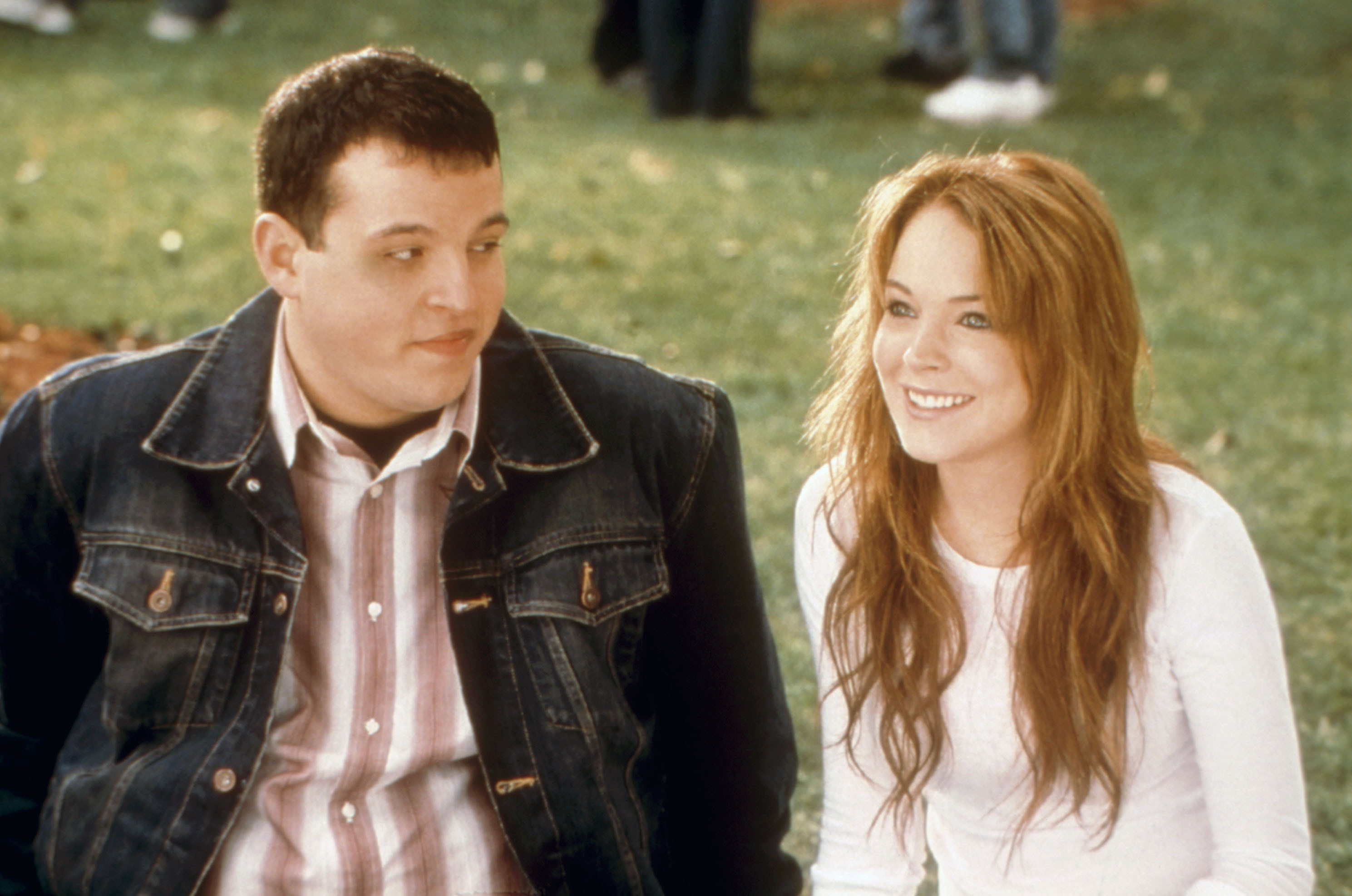 Daniel Franzese and Lindsay Lohan sit on the lawn