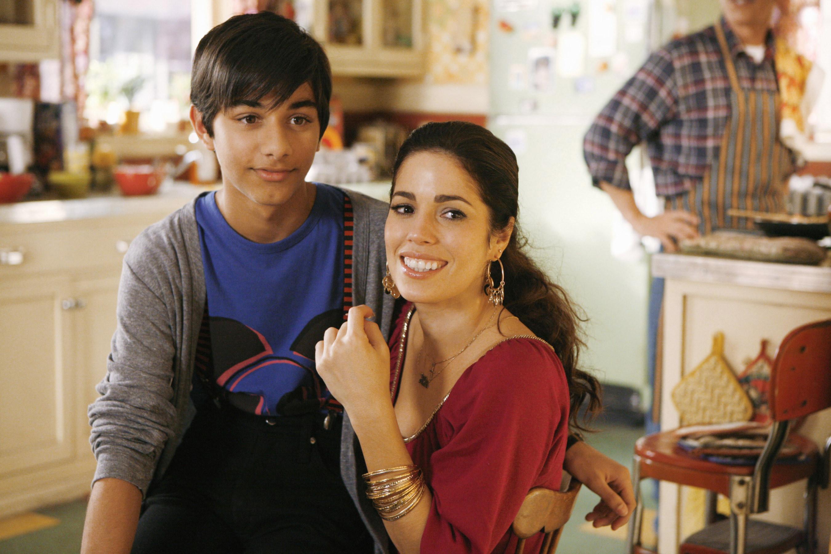 Mark Indelicato sits on Ana Ortiz's lap