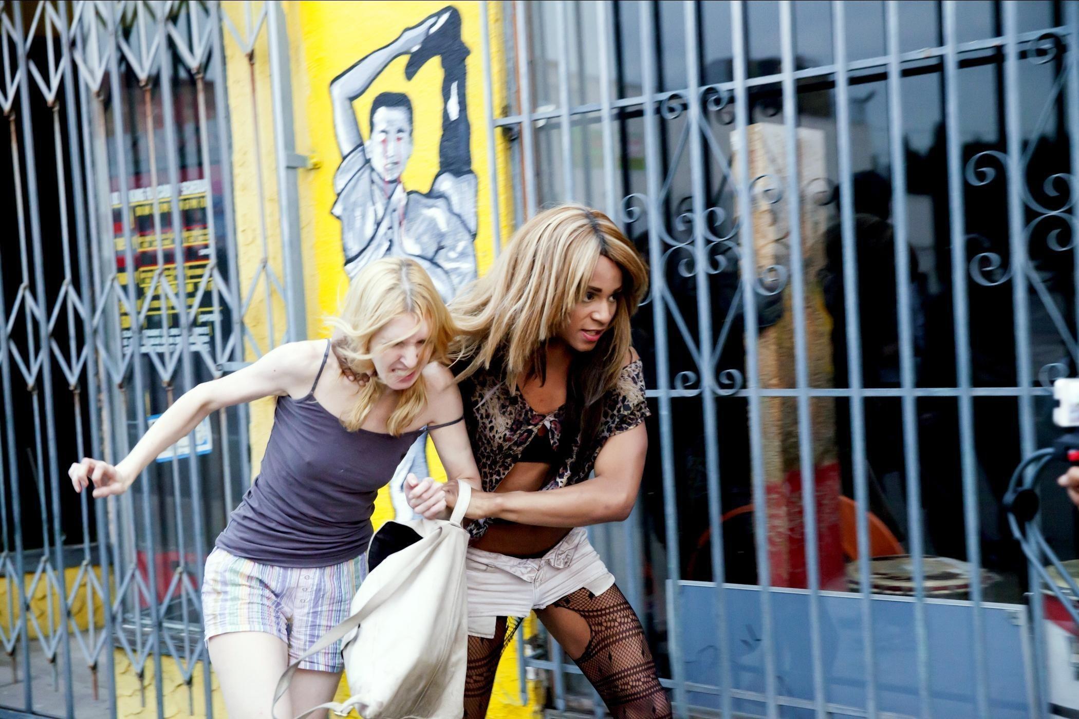 Kitana Kiki Rodriguez drags Mickey O'Hagan down the street by the neck