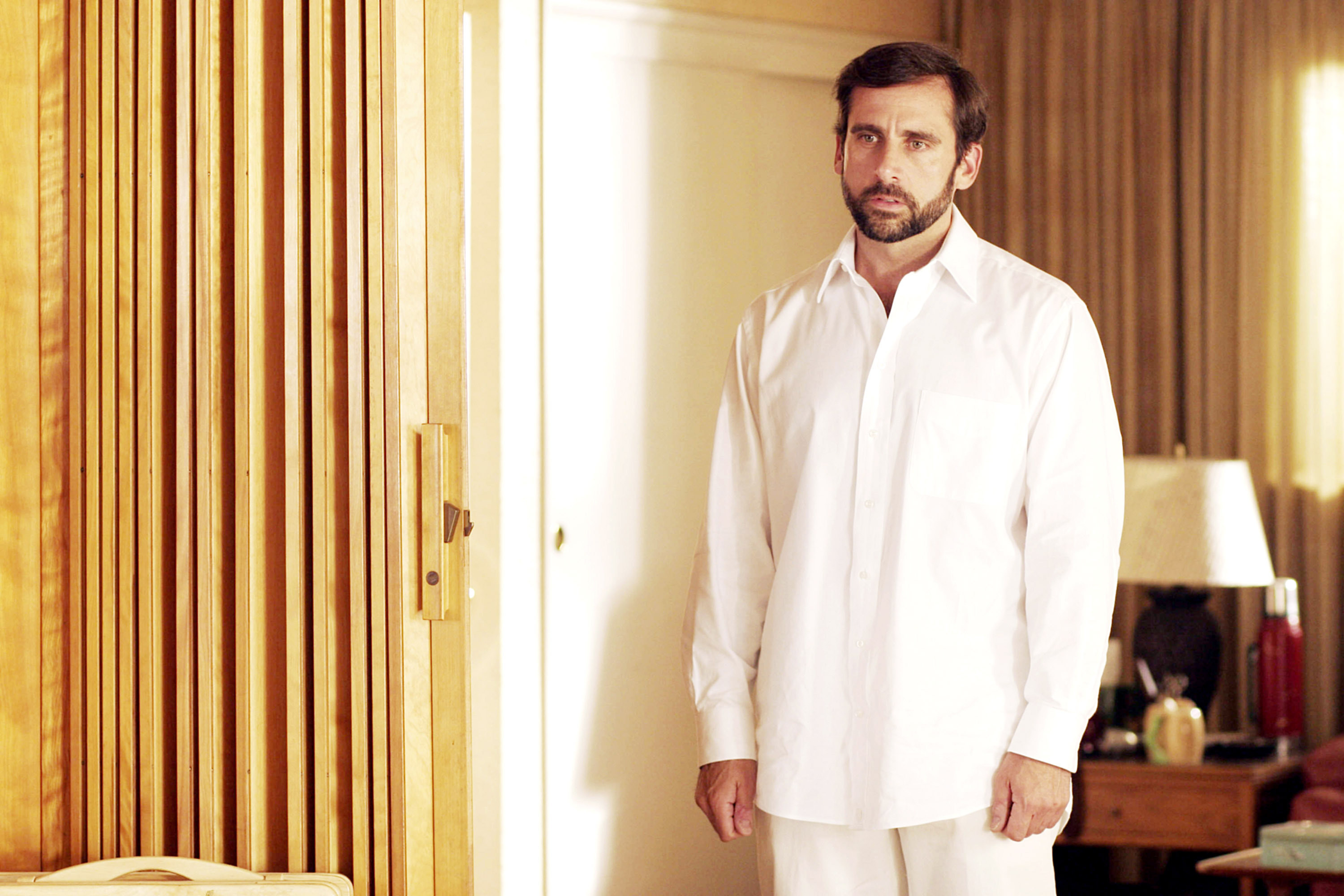 Steve Carell, all in white, looking depressed