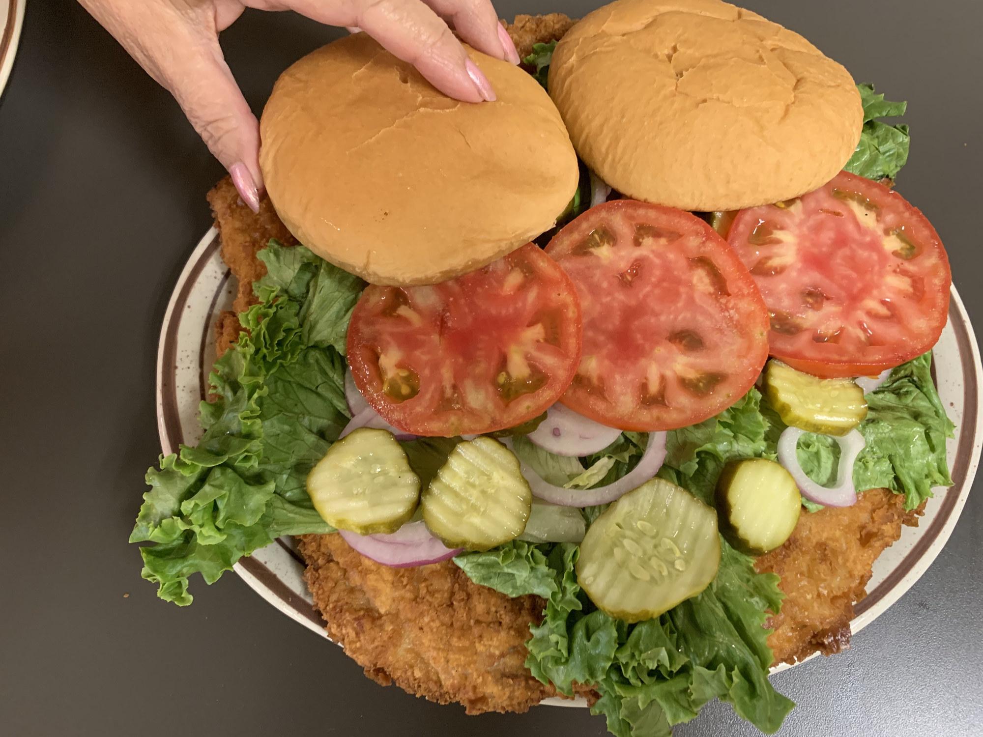 Oversize pork tenderloin sandwich