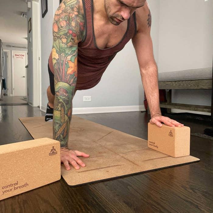 Reviewer using the luxury performance cork yoga blocks
