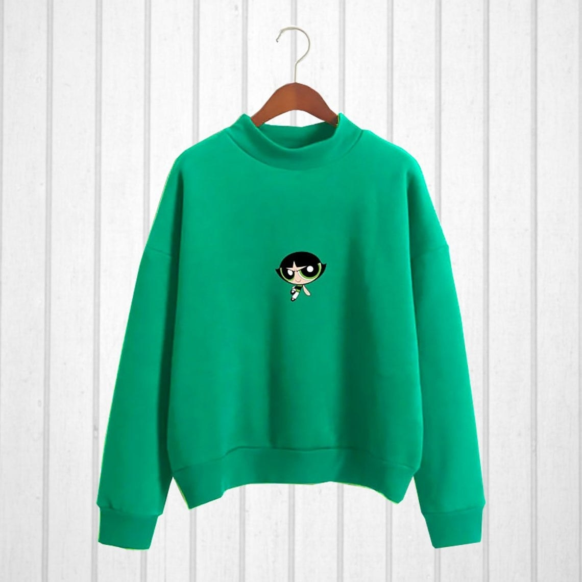 A vibrant crew neck sweater with an image of Buttercup on the front