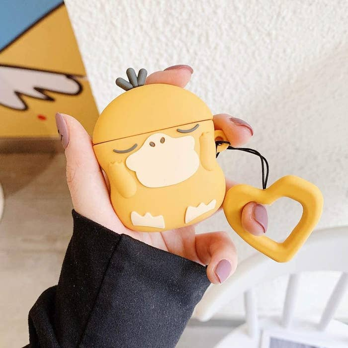 a person holding the psyduck airpods case