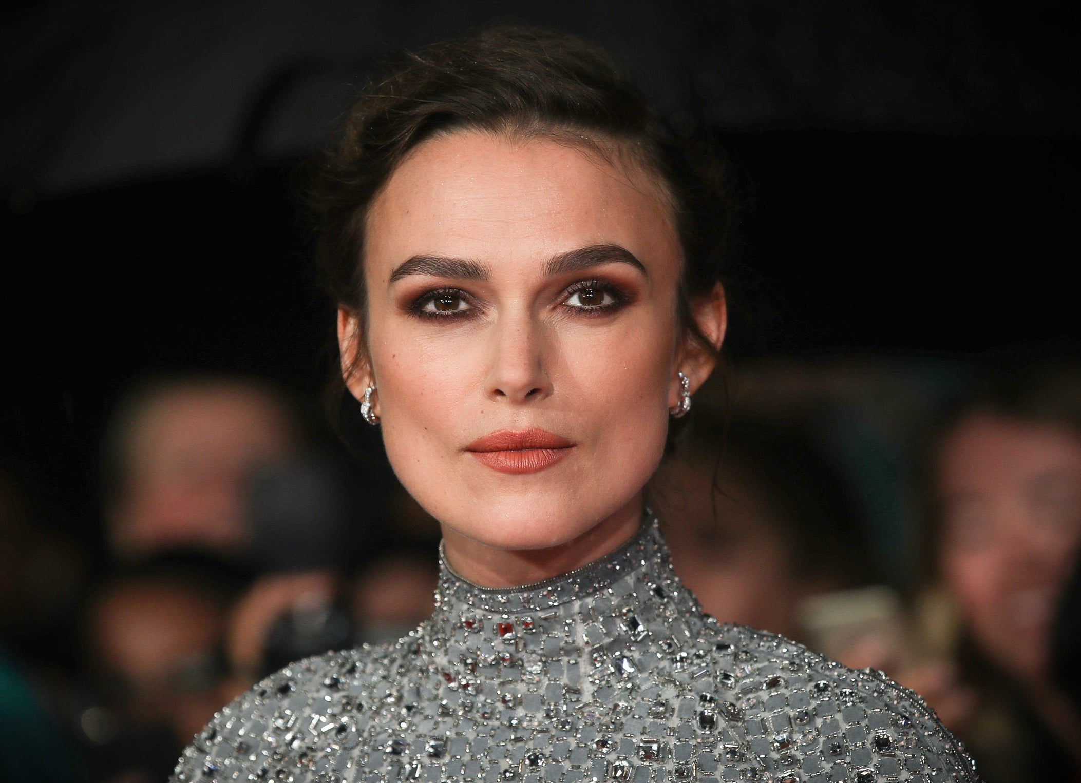 Keira looks serious while attending an event