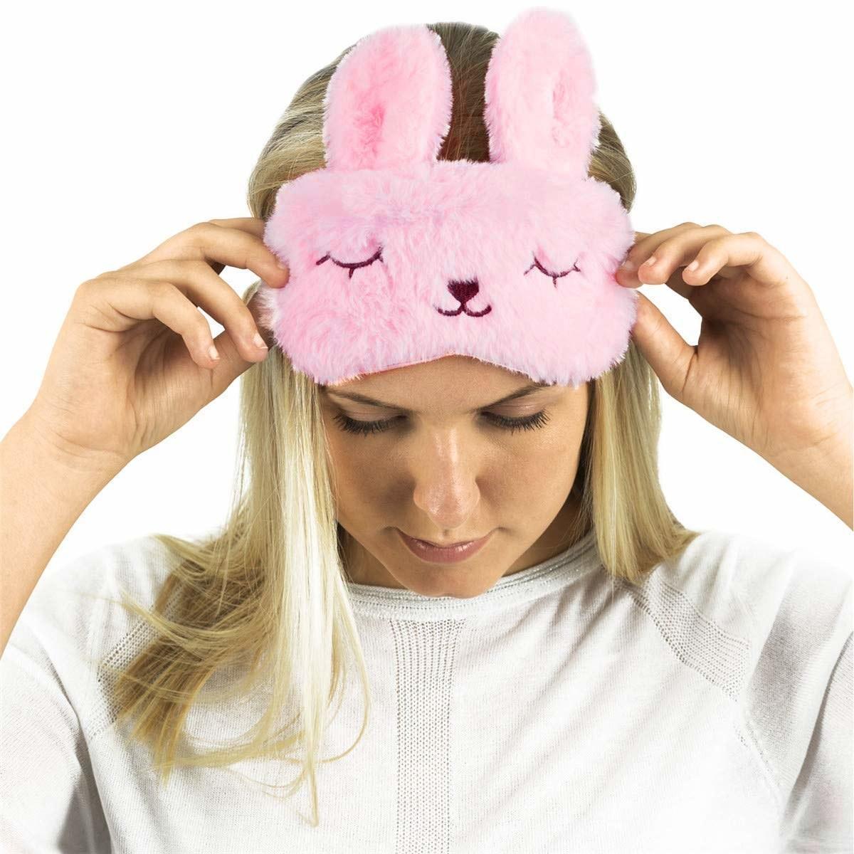 A fluffy pink bunny-shaped eye mask.