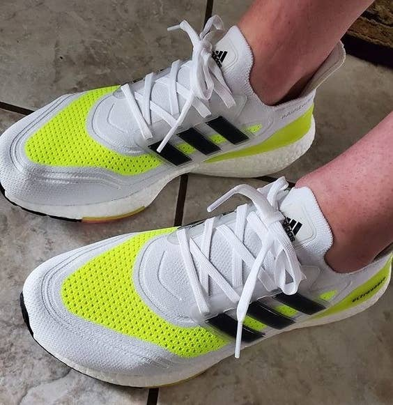 Reviewer's picture of them wearing the sneakers