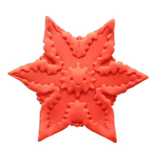 Orange star-shaped silicone vibrator with detailed ridges and a smiley in the middle