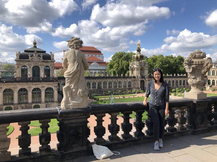 The author pictures in Dresden, leaning on the second floor of a baroque building.