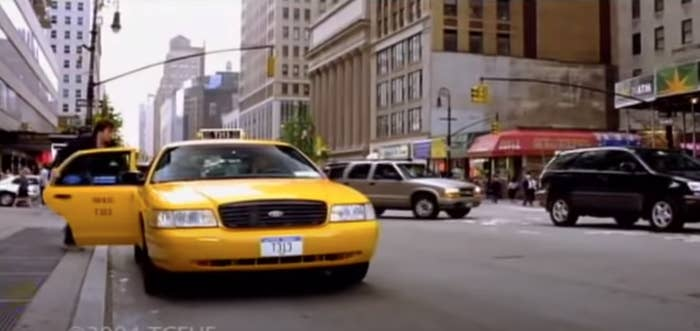 """Jimmy Fallon gets into a taxi during a scene in """"Taxi"""""""