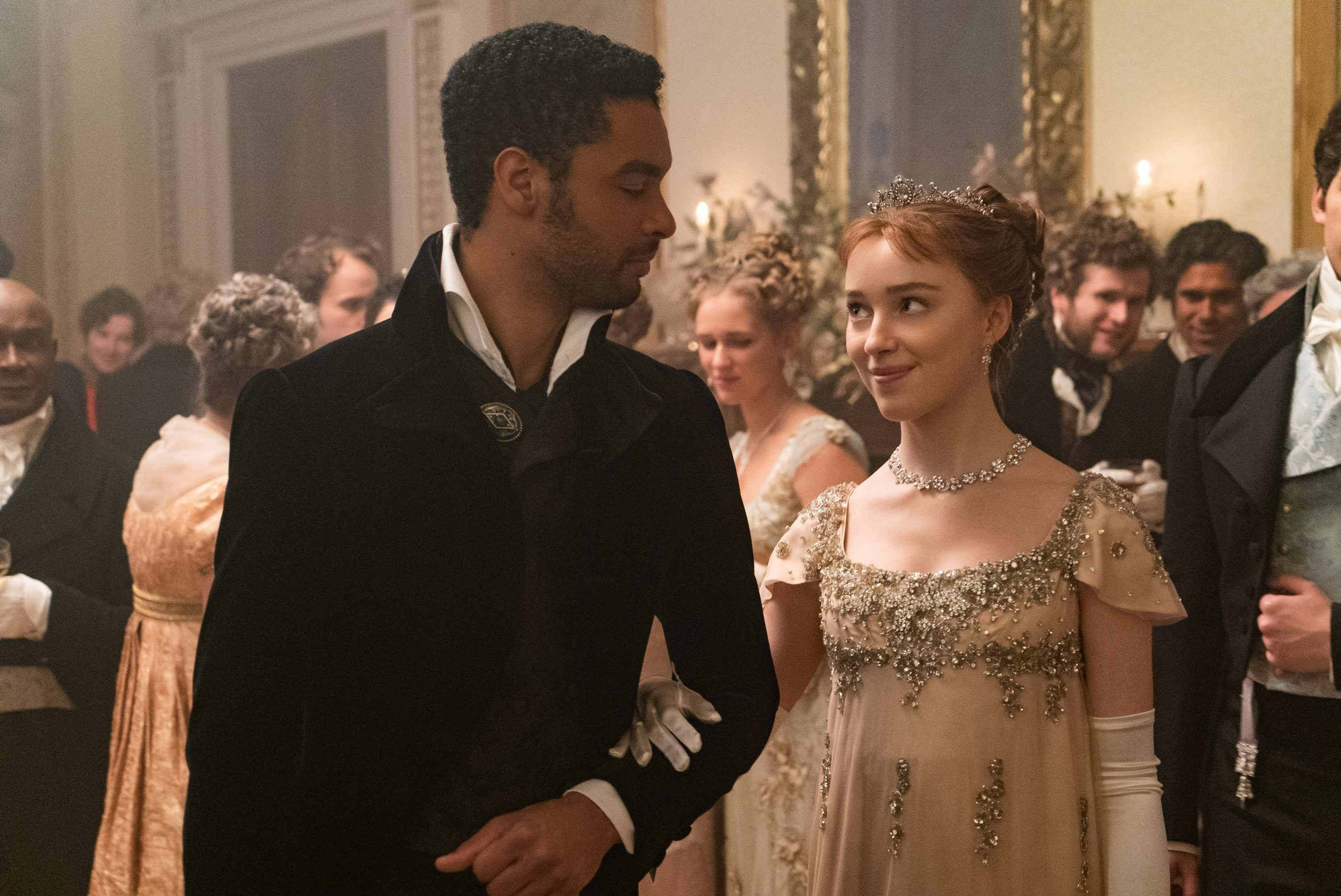 Phoebe and Regé at a ball in a scene from Bridgerton