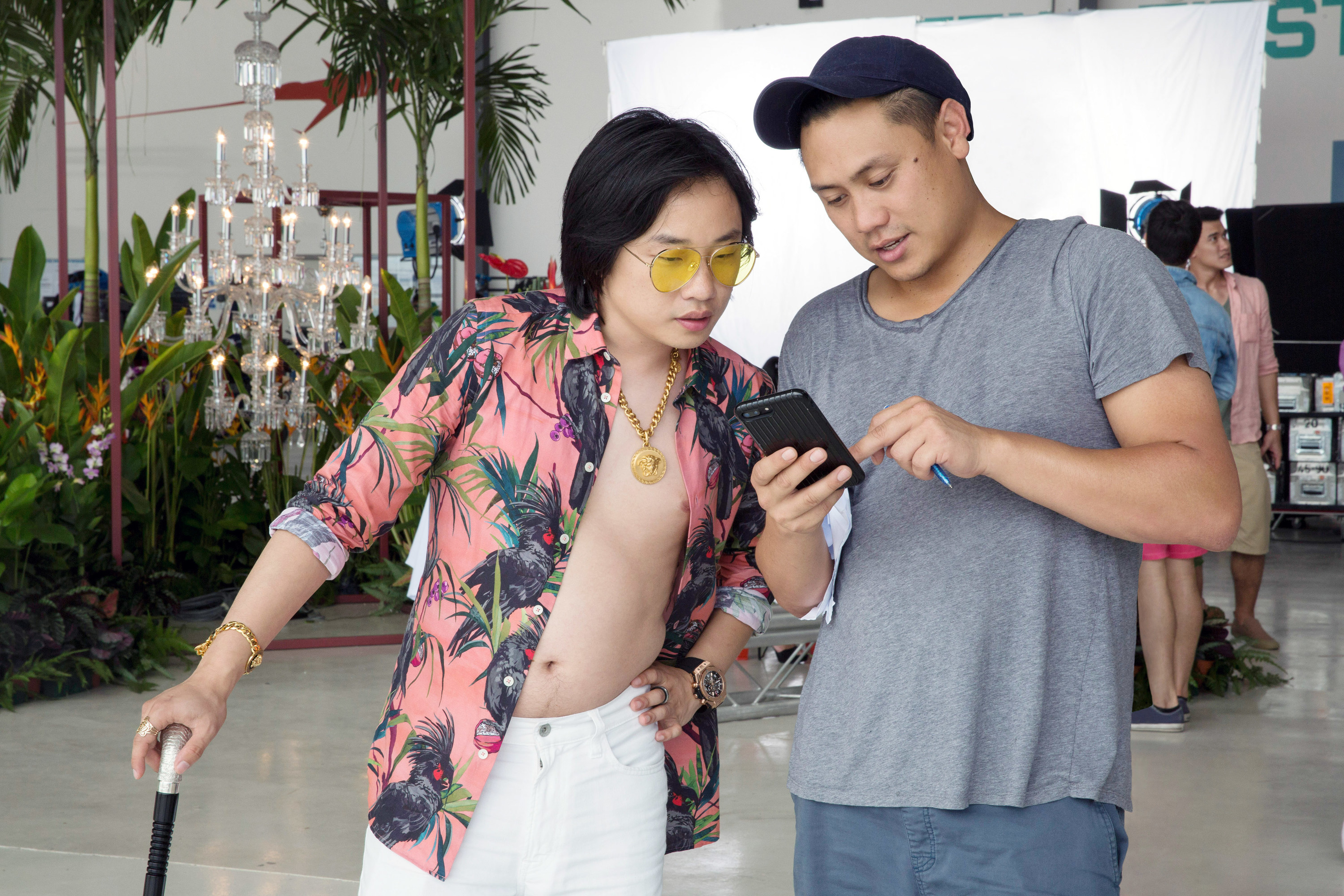 """Actor Jimmy O. Yang and director Jon M. Chu review notes on set of """"Crazy Rich Asians"""""""