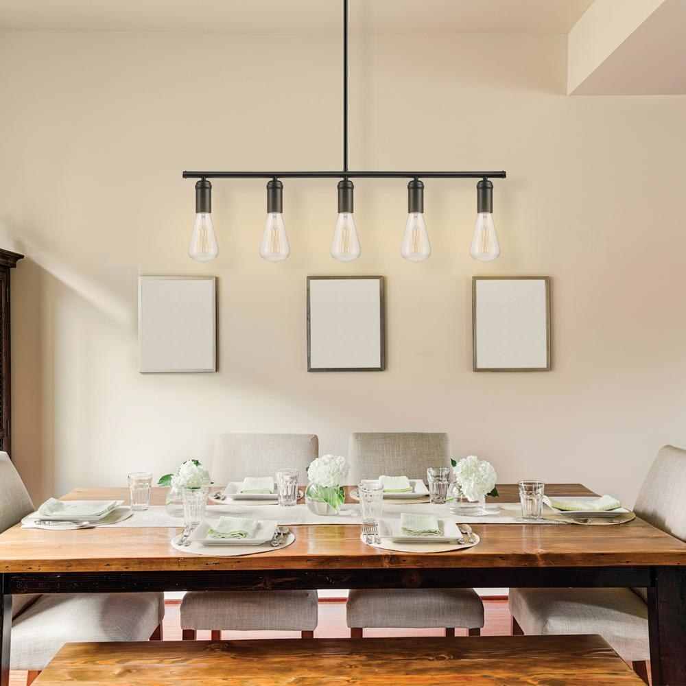 The light hanging above a dining room table