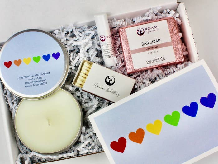 The self-care kit with rainbow hearts-themed goodies in a square box