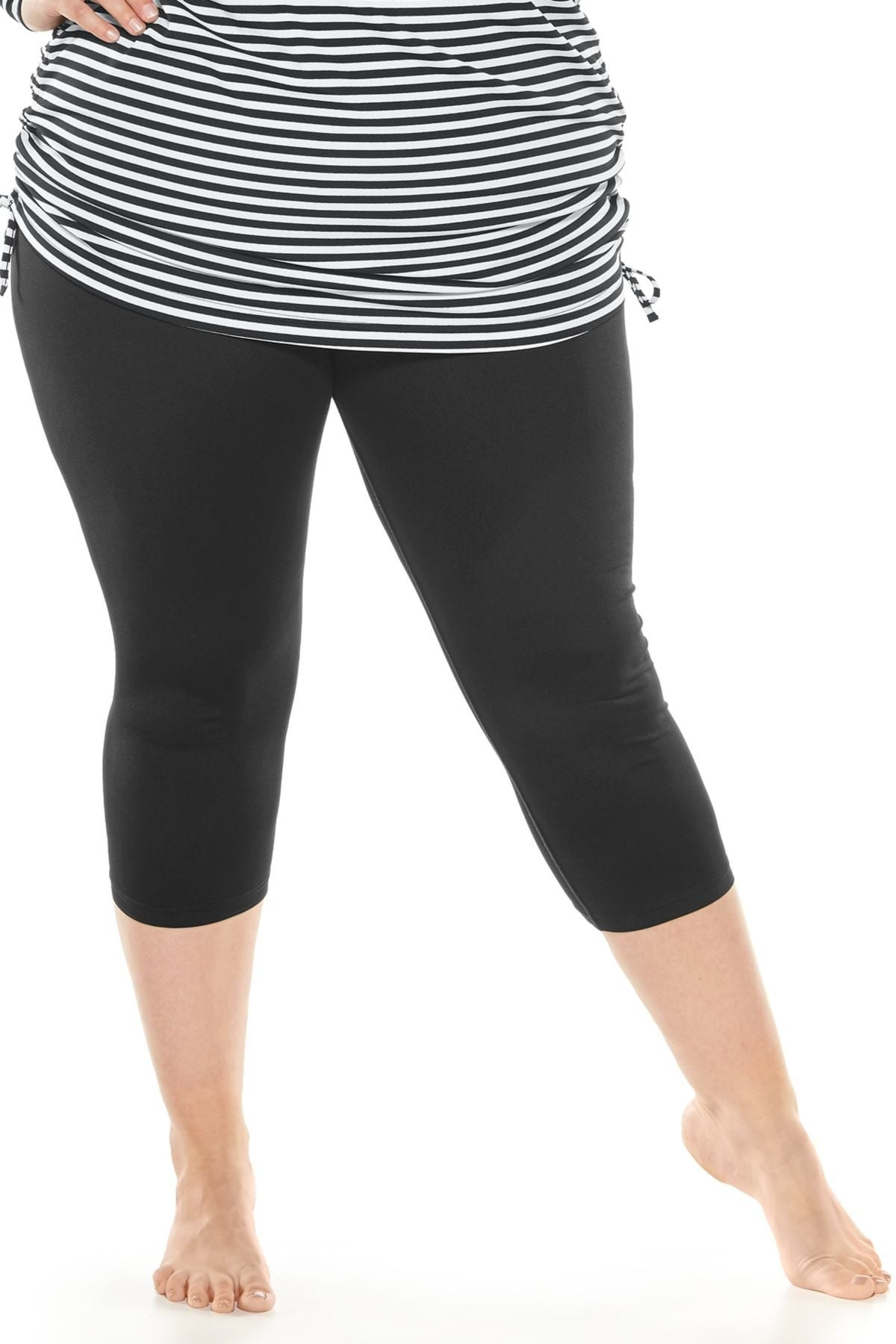 model in black mid-calf leggings