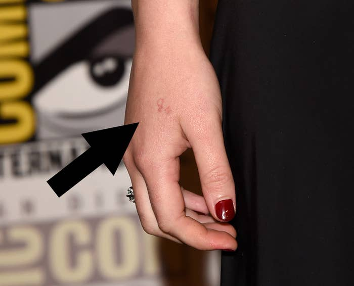 Close-up of Jennifer Lawrence's hand and an arrow pointing to the tattoo