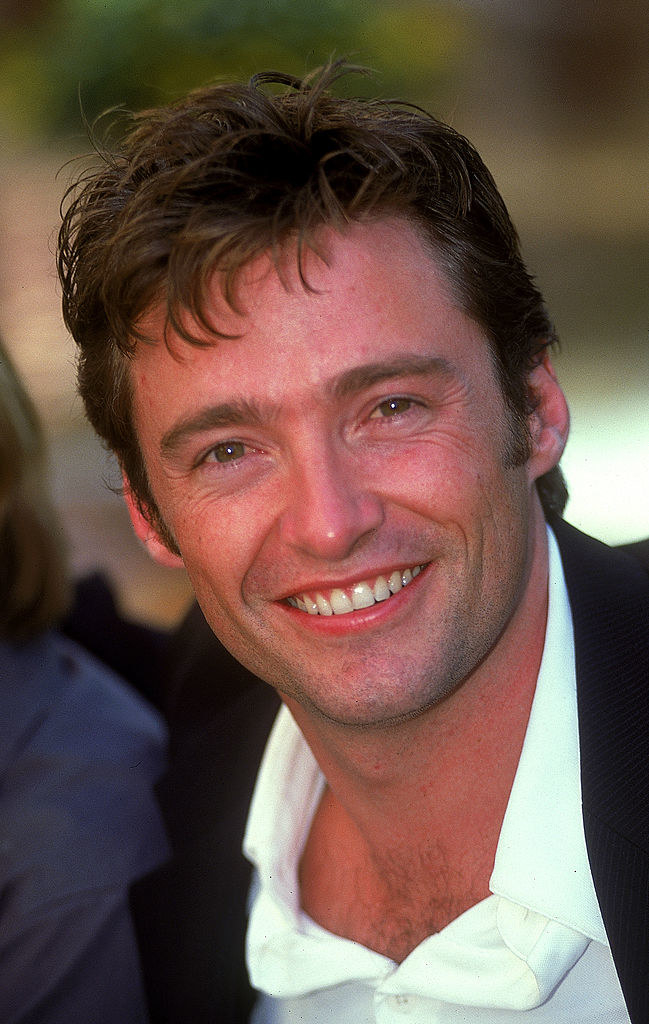 A smiling Hugh showing some chest hair too