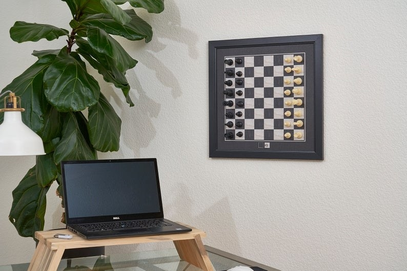 the magnetic chess board hanging on a wall