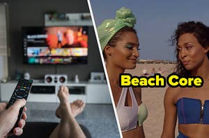 """A hand holds out a TV remote while a pair of legs are stretched out in front of a TV and Blanca, wearing a blue strapless swim suit, stands next to Angel, wearing a one shoulder green and white swim suit, during an episode of """"Pose."""""""