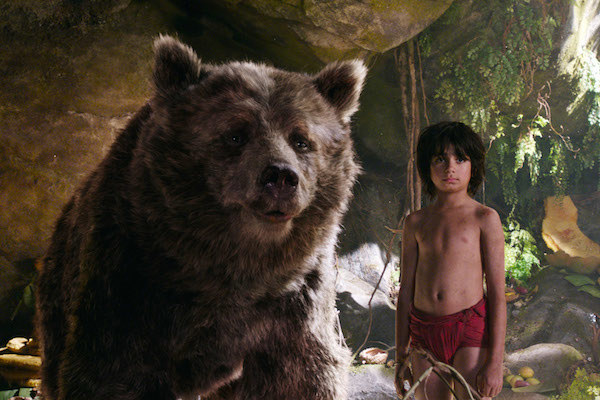 Baloo (voiced by Bill Murray) standing next to Neel Sethi