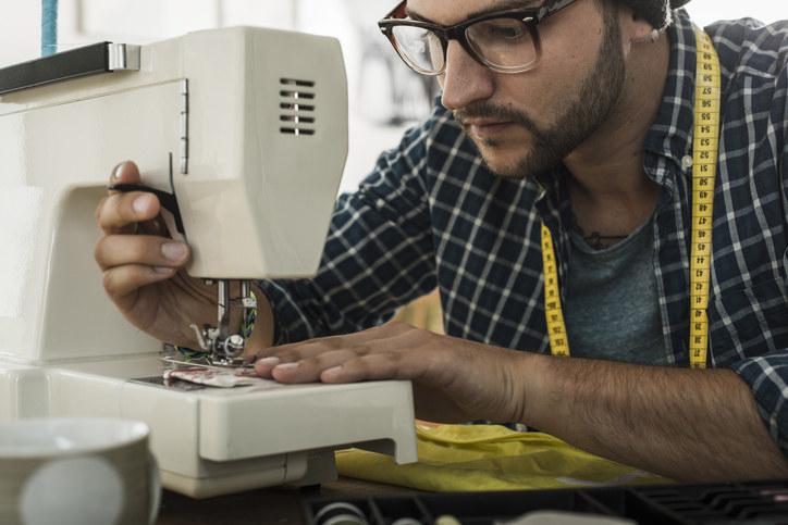 Man using a sewing machine