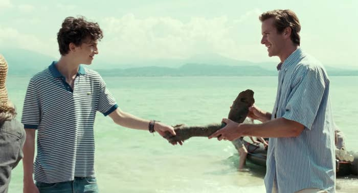 Armie Hammer and Timothee Chalamet laughing in a Call Me By Your Name scene