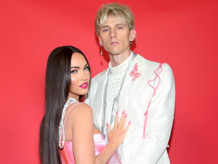 Megan and Machine Gun Kelly pose together at an event