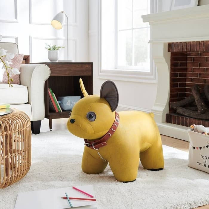 The dog ottoman in yellow, in a living room
