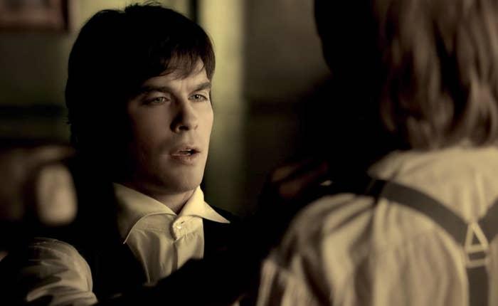 Damon fixing young Stefan's shirt