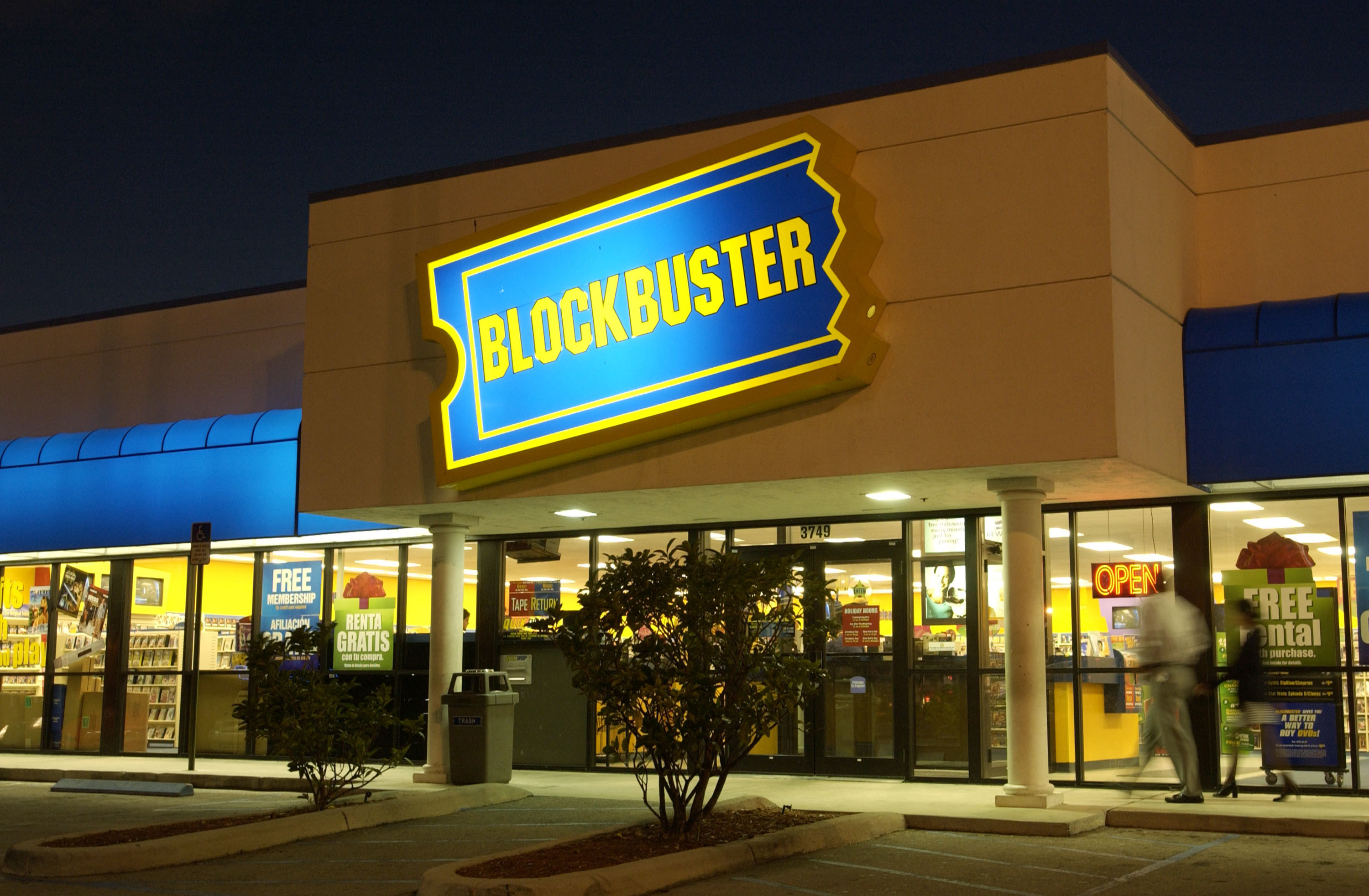A photo of the outside of a Blockbuster Video store at night