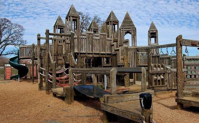 A wooden playground at a park