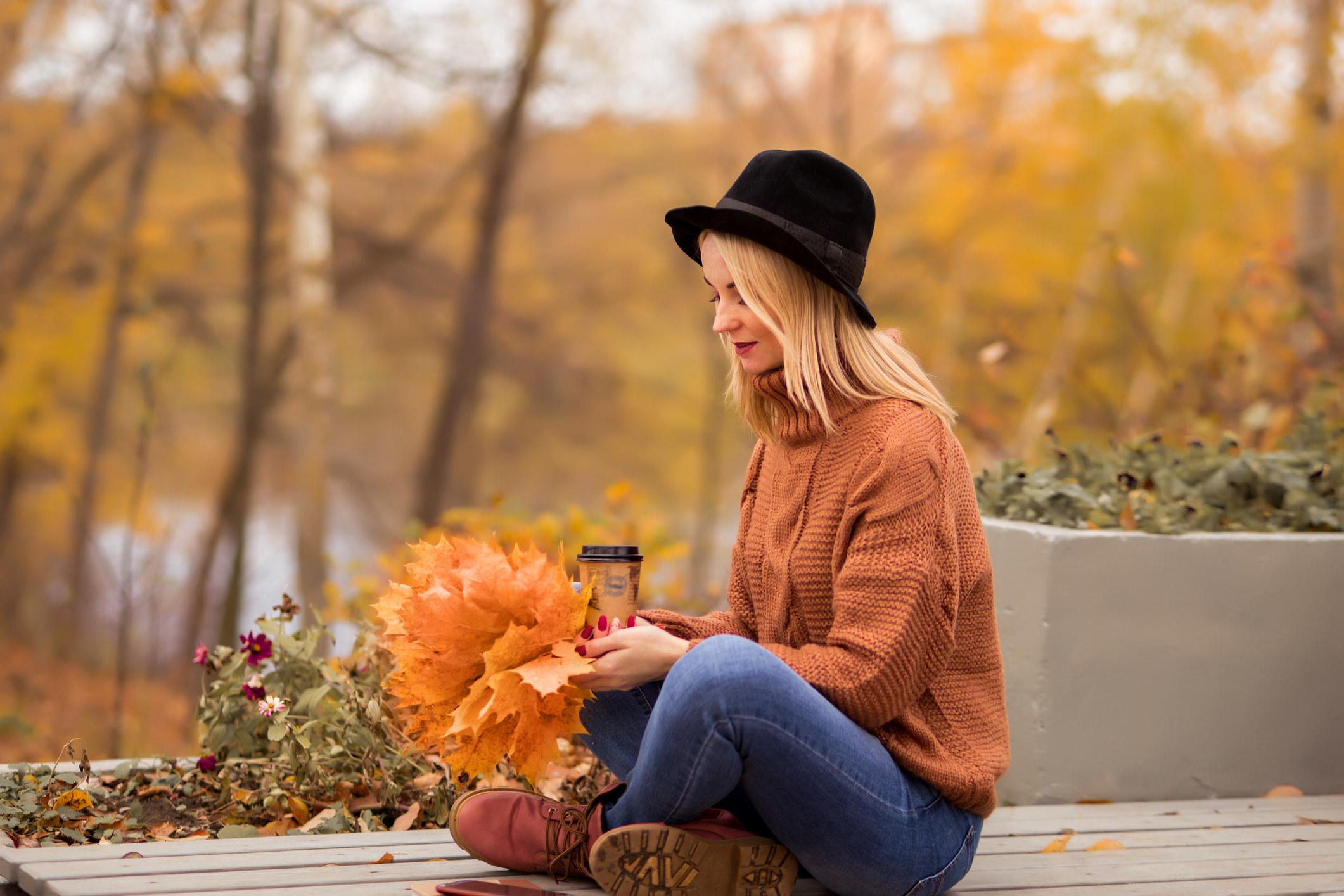 a girl celebrating fall