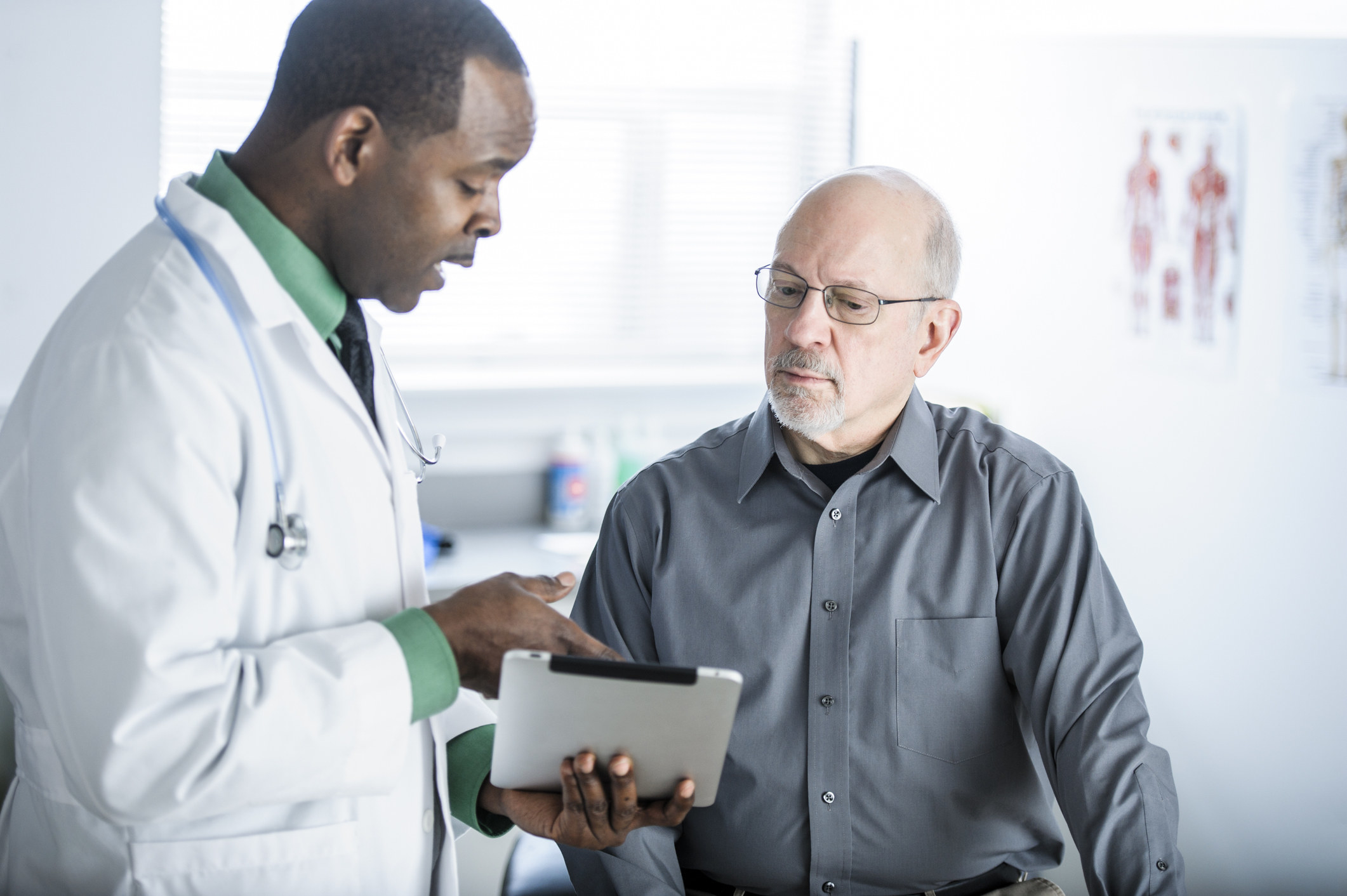 A doctor explaining something to a patient