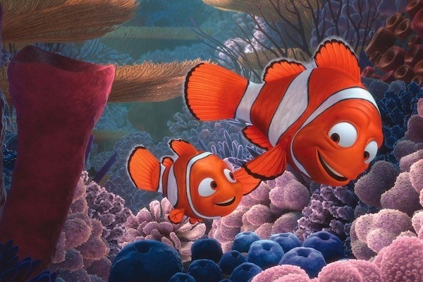 Nemo (Alexander Gould) and Marlin (Albert Brooks) swimming together.