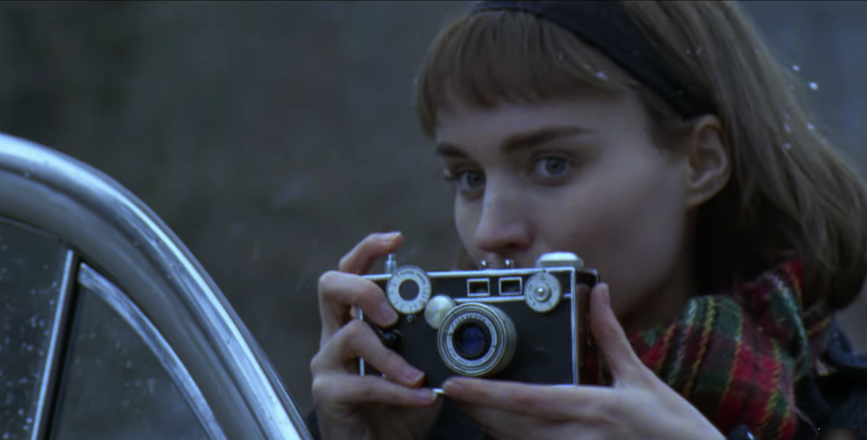 Therese takes a photo of Carol