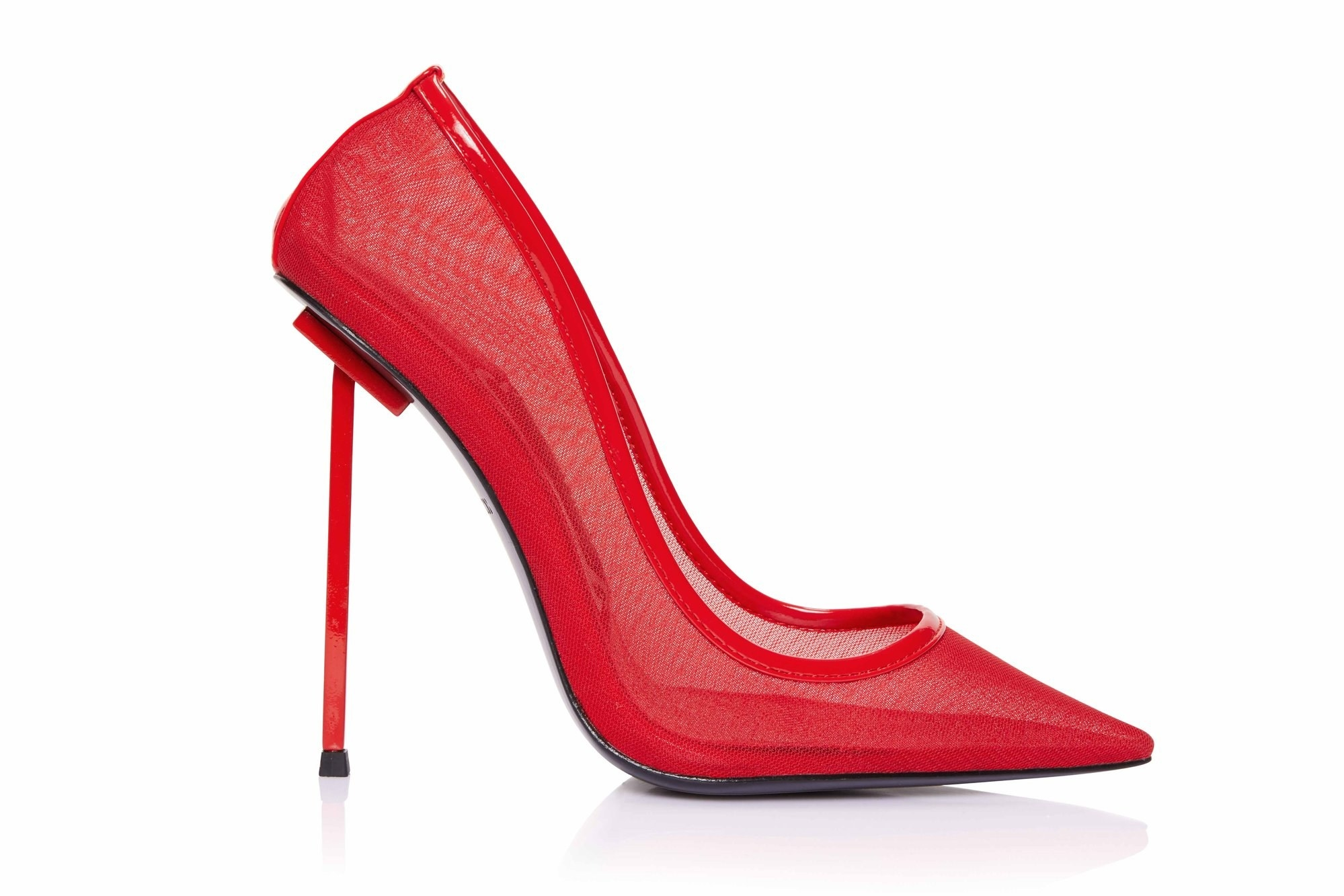 read pumps with a pointed toe and made of mesh with solid red leather trim around the edge. It's got a super skinny stiletto heel.