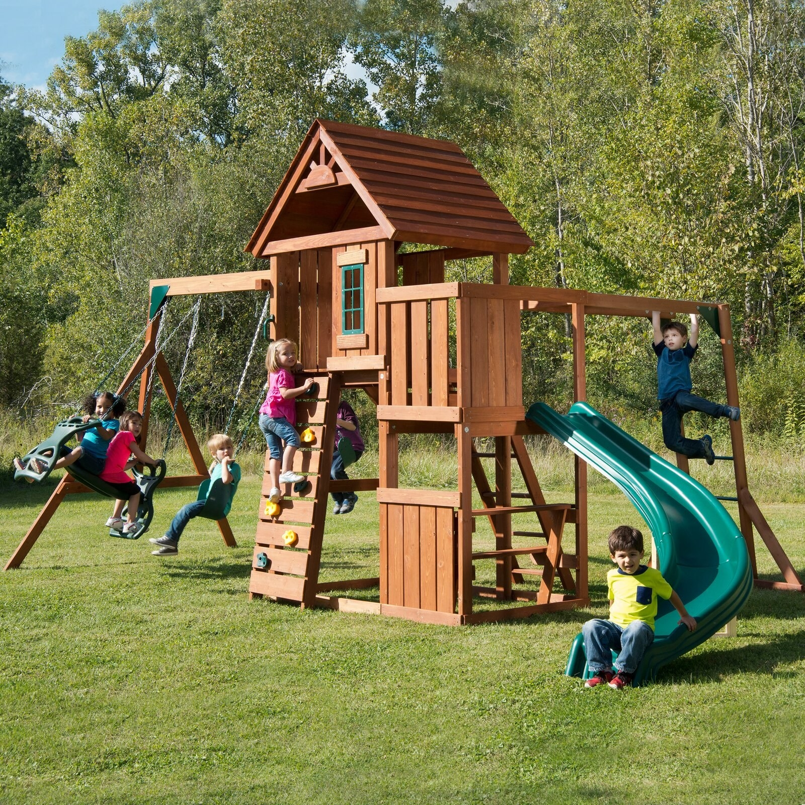 The swing set with kids playing on it