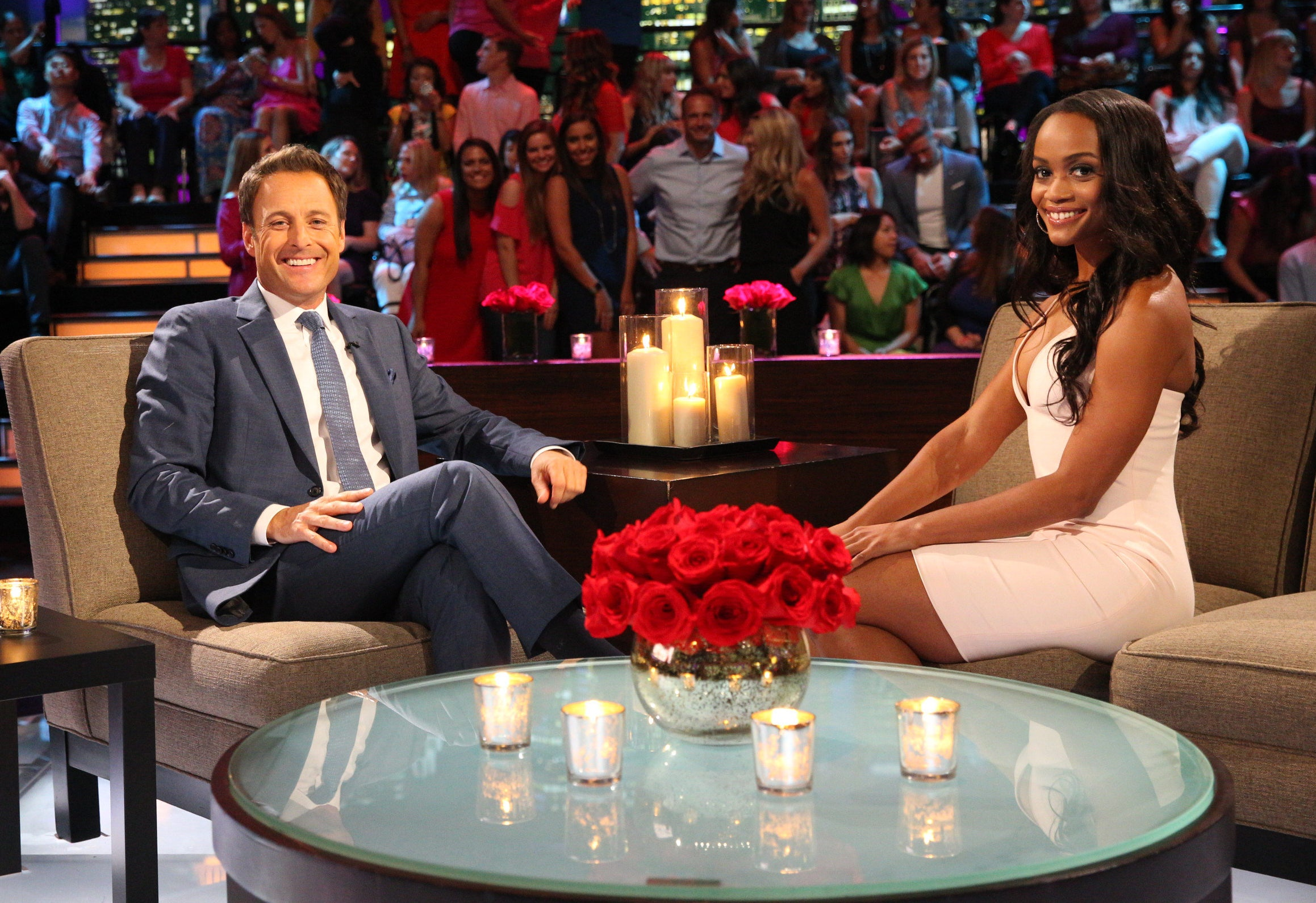 Rachel sits across from Chris at a Bachelor taping