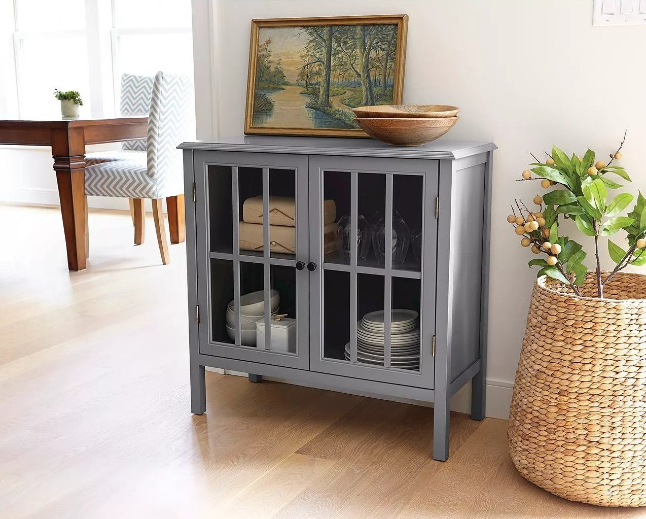 The cabinet with two glass doors in a living room