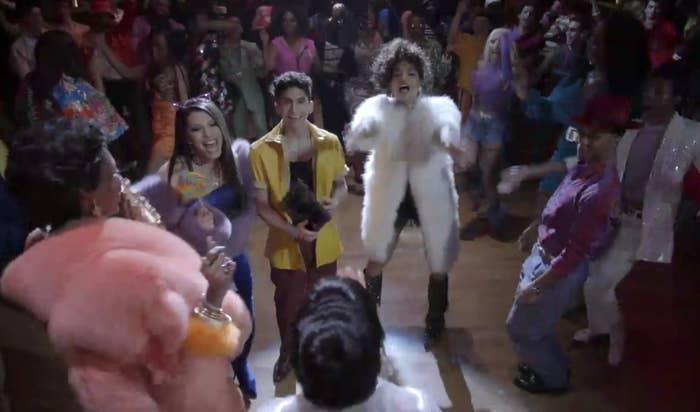 Elektra, Lulu, Papi, Angel, and Ricky surrounding Blanca on the dancefloor
