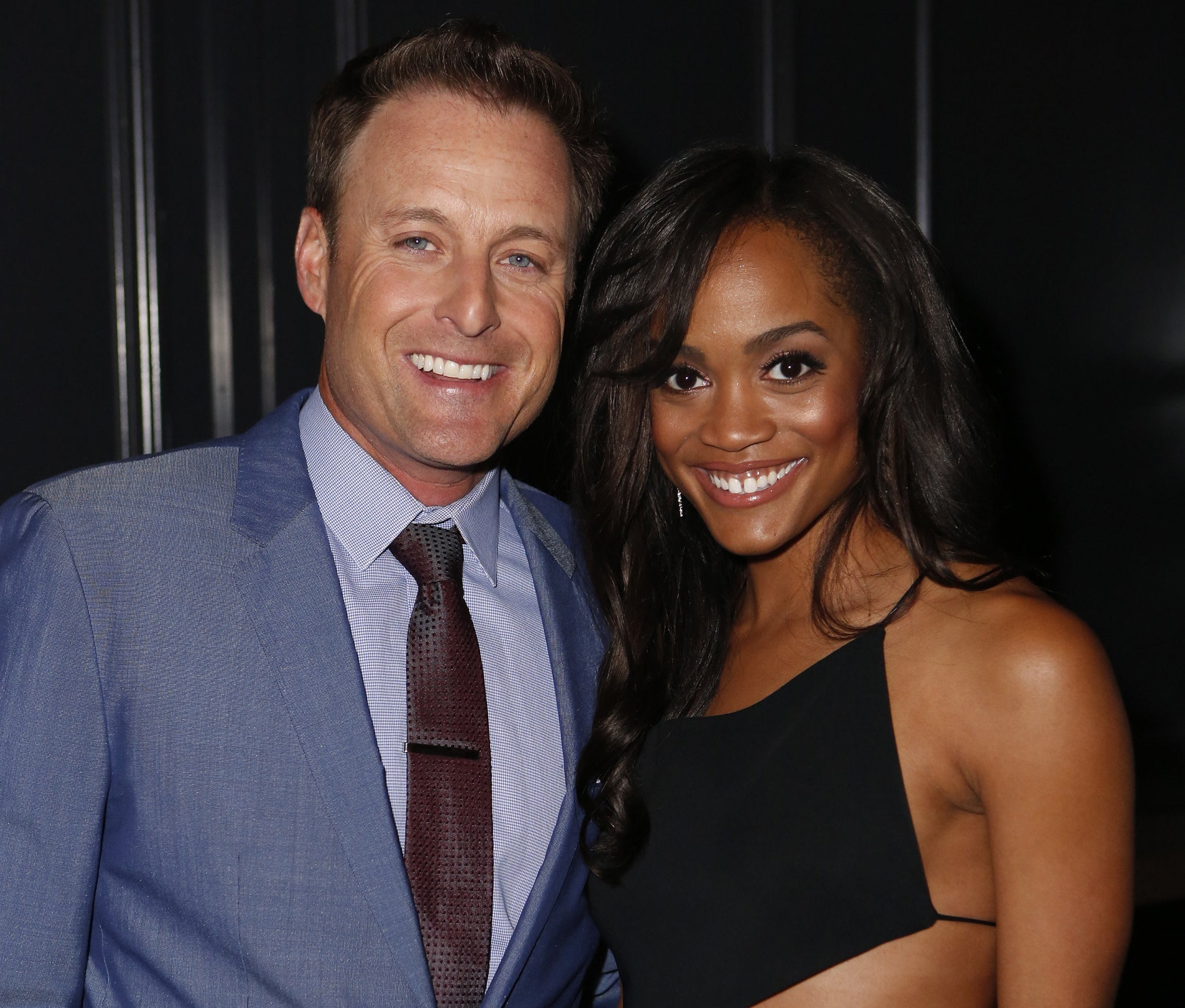 Rachel and Chris smile while attending a Bachelor event
