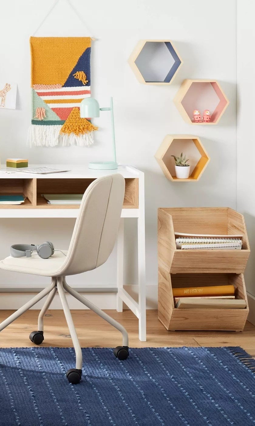The hexagon-shaped shelves in different colors hanging on an office wall