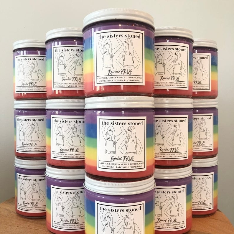 """Rainbow soy candles with """"the sisters stoned"""" labels on front"""