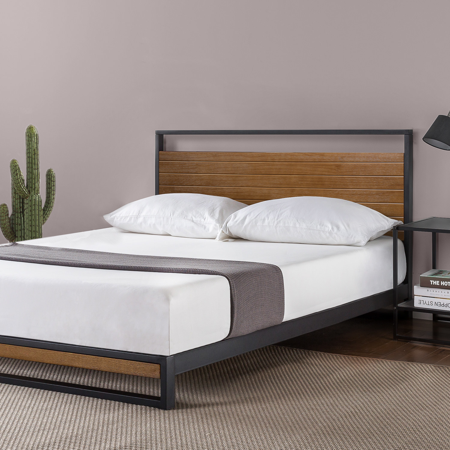 a bedframe with metal frame and wooden headboard