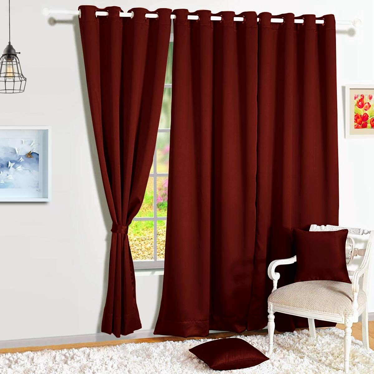 A pair of maroon blackout curtains on a window.