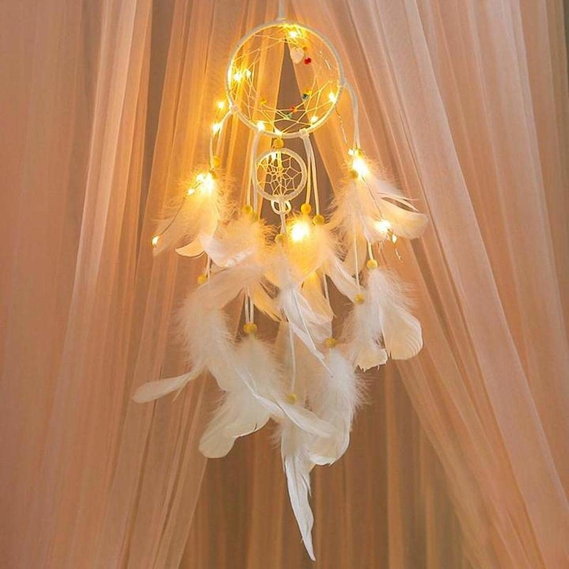 A feathery LED dreamcatcher beside a canopy