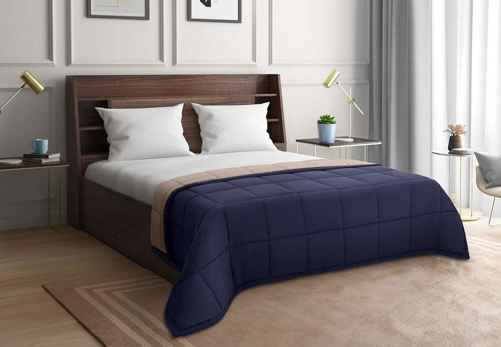 A navy blue microfibre duvet cover on a  bed.